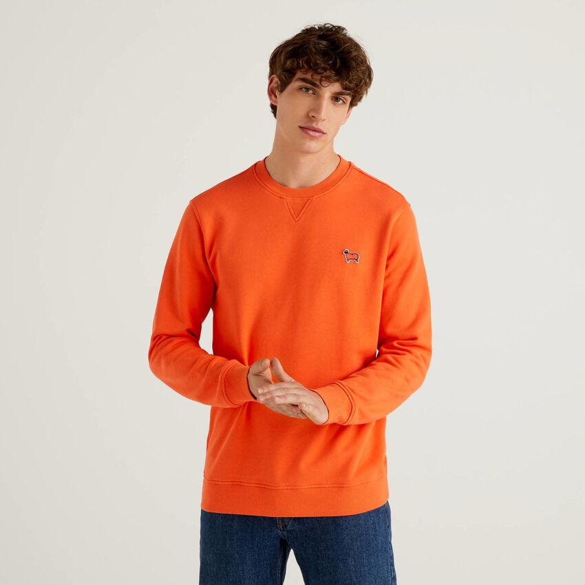 Solid colored sweatshirt in organic cotton