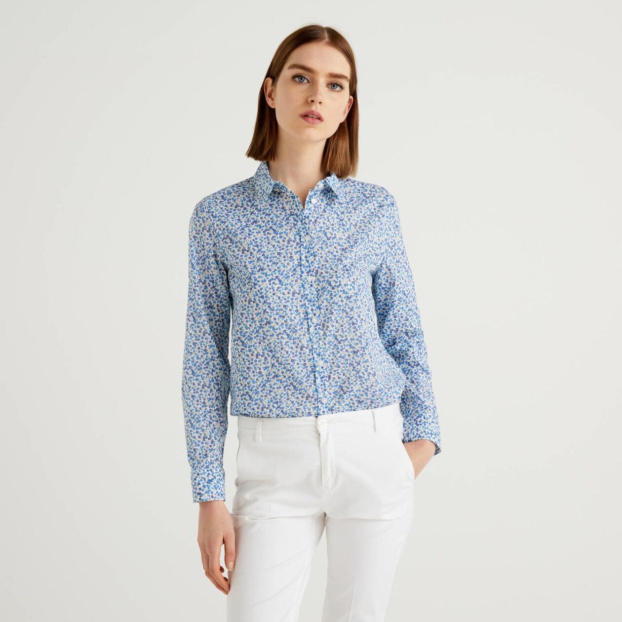 100% cotton light blue shirt with floral print