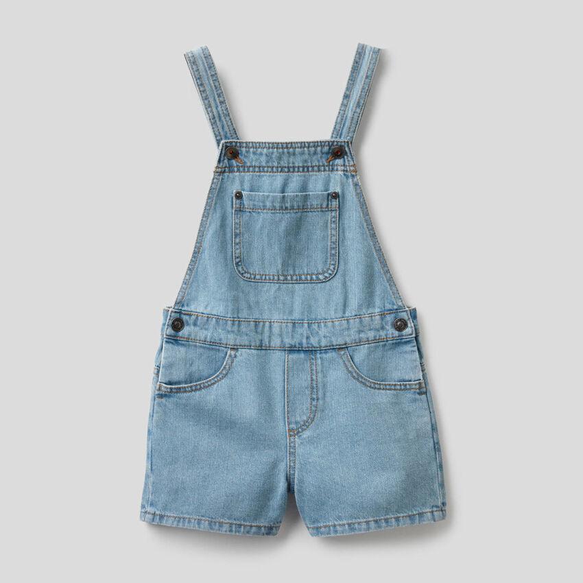 Short overalls in 100% cotton denim