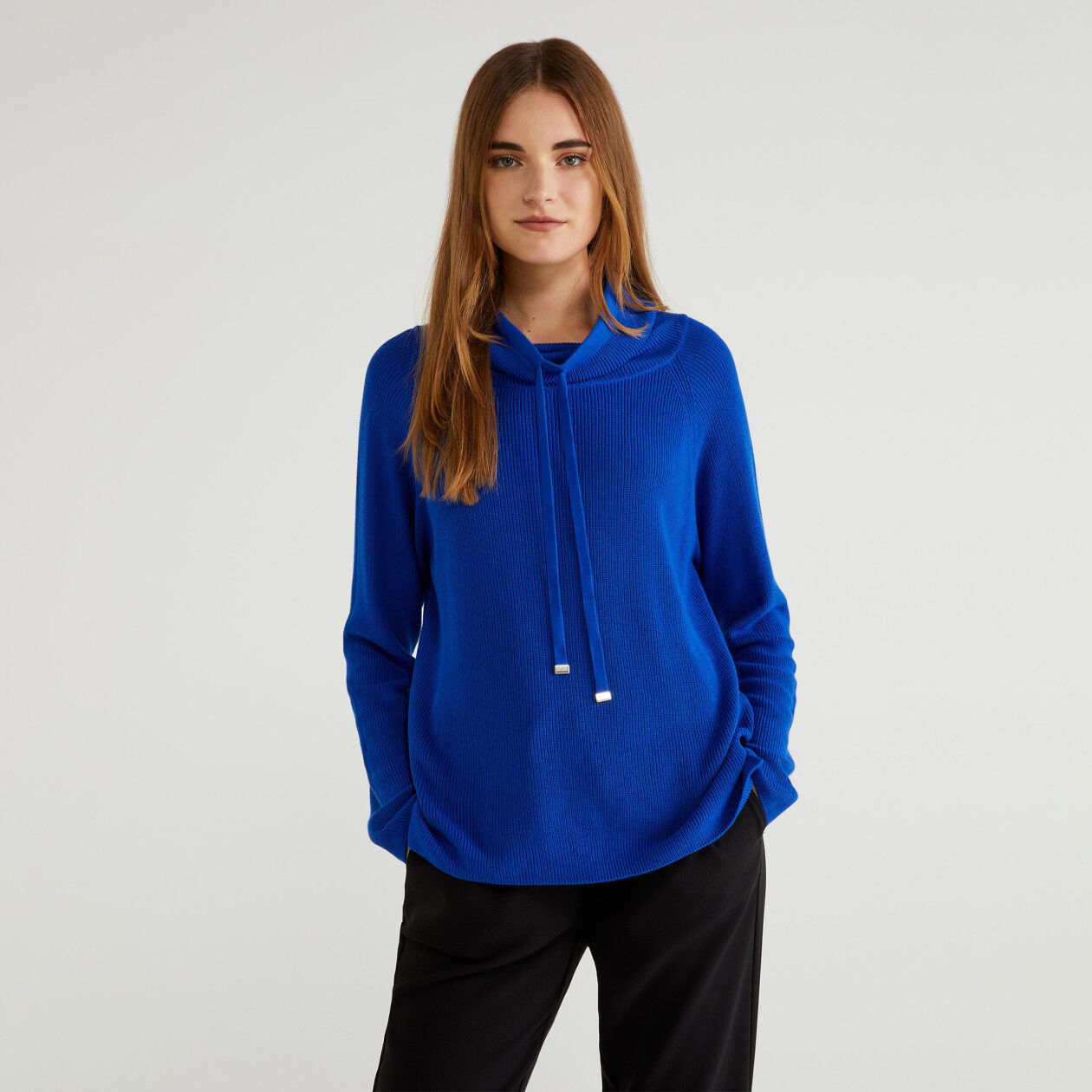 High neck sweater with drawstring