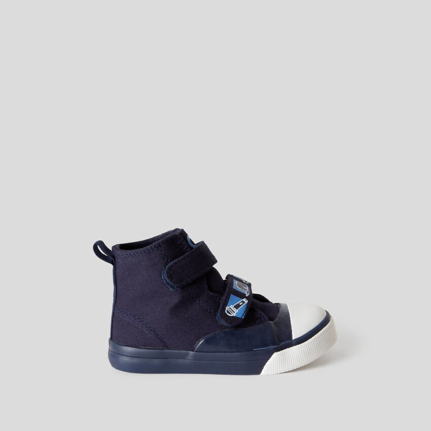 High-top sneakers with strap closure