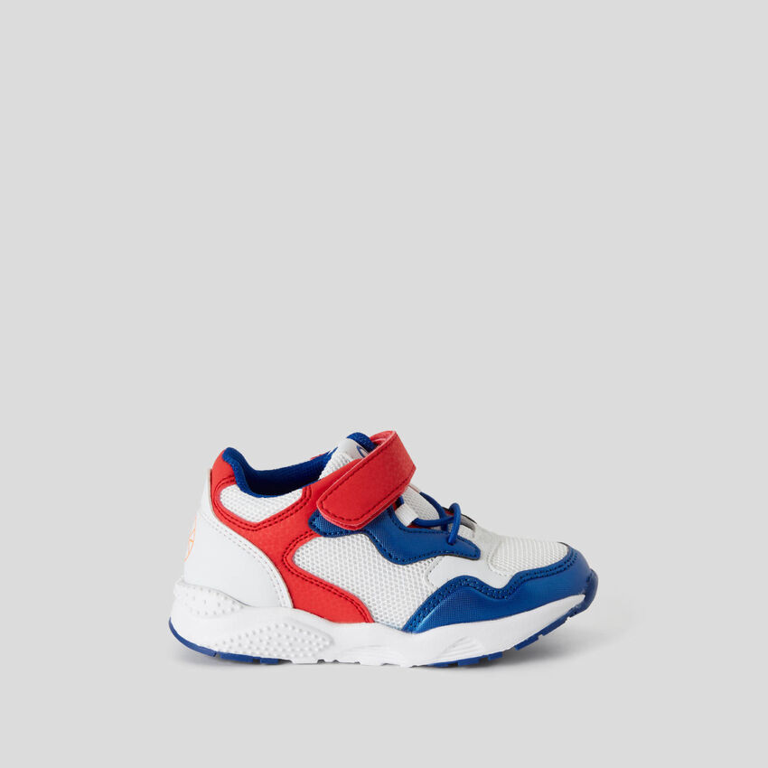 Sneakers with strap closure