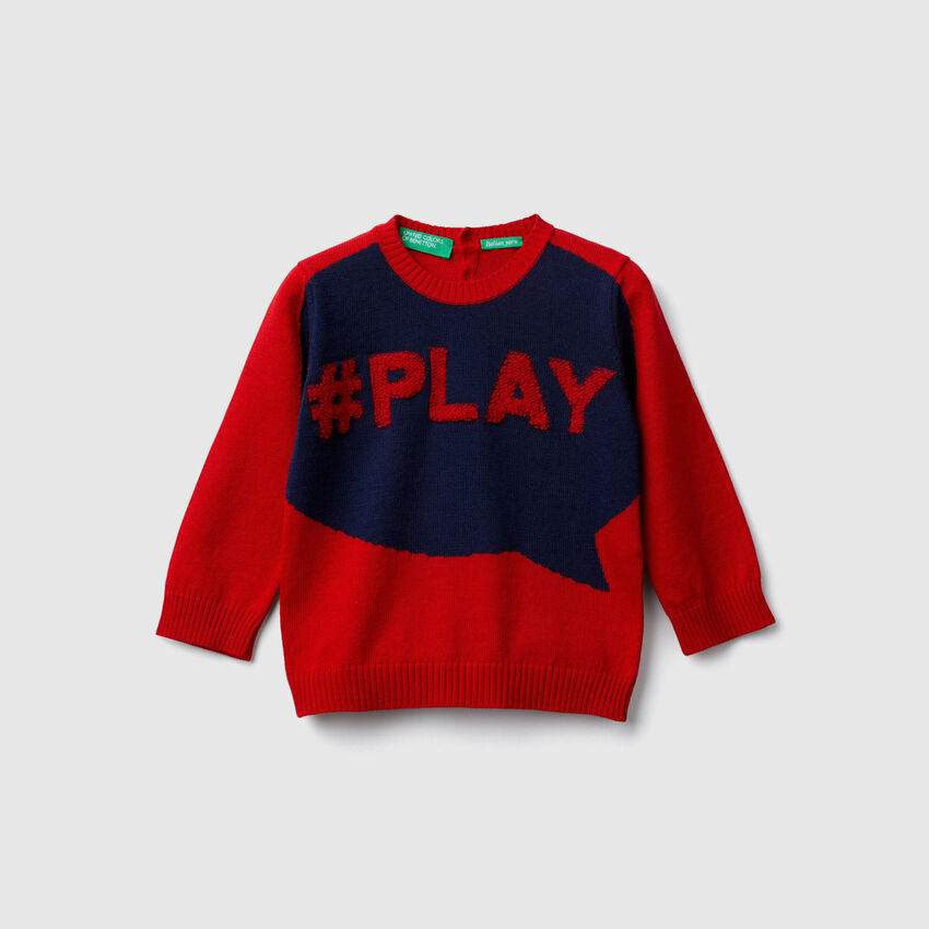 Sweater with inlay and writing